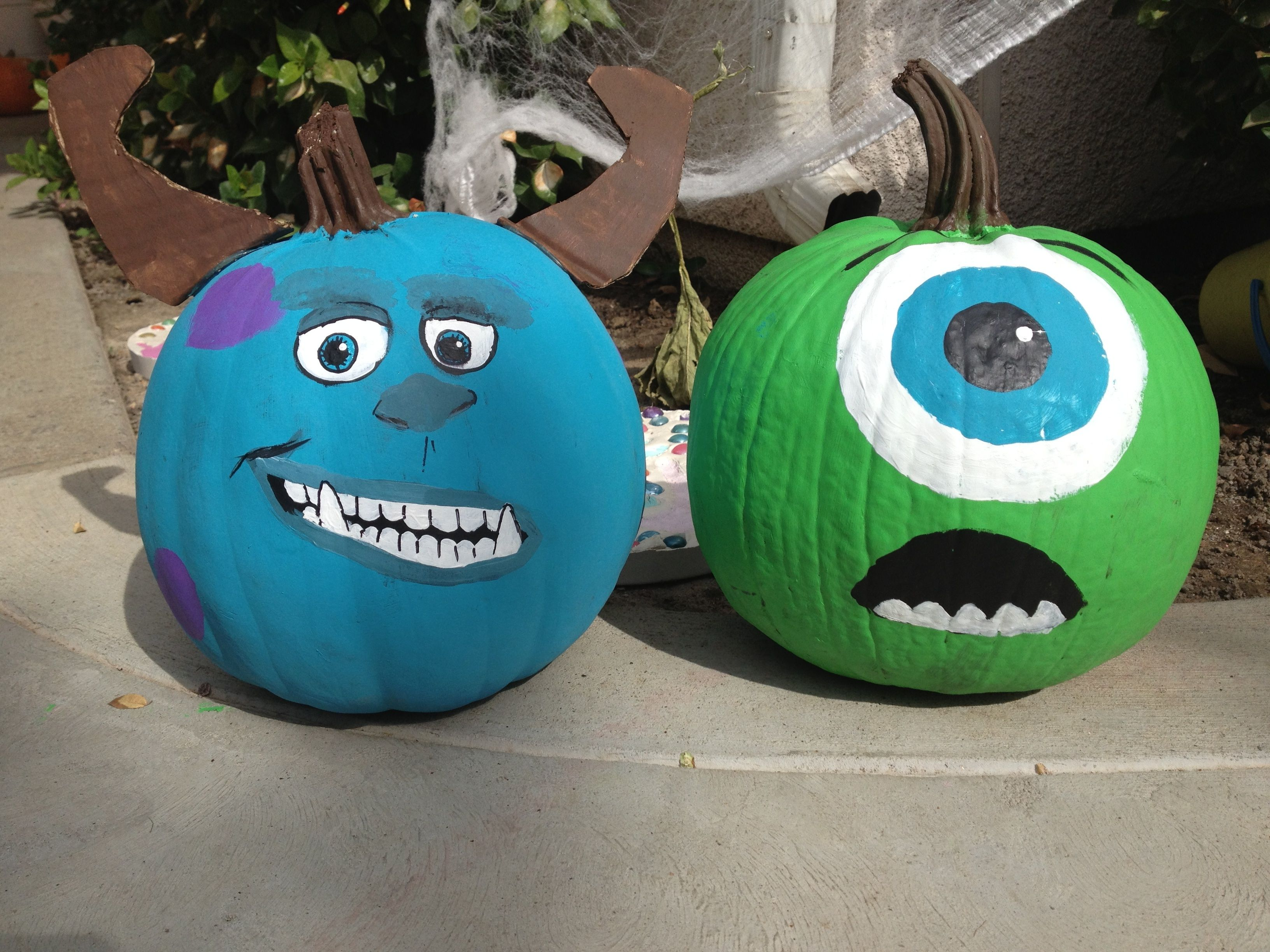 Turned my green pumpkins into Sulley and Mike Wazowski ...