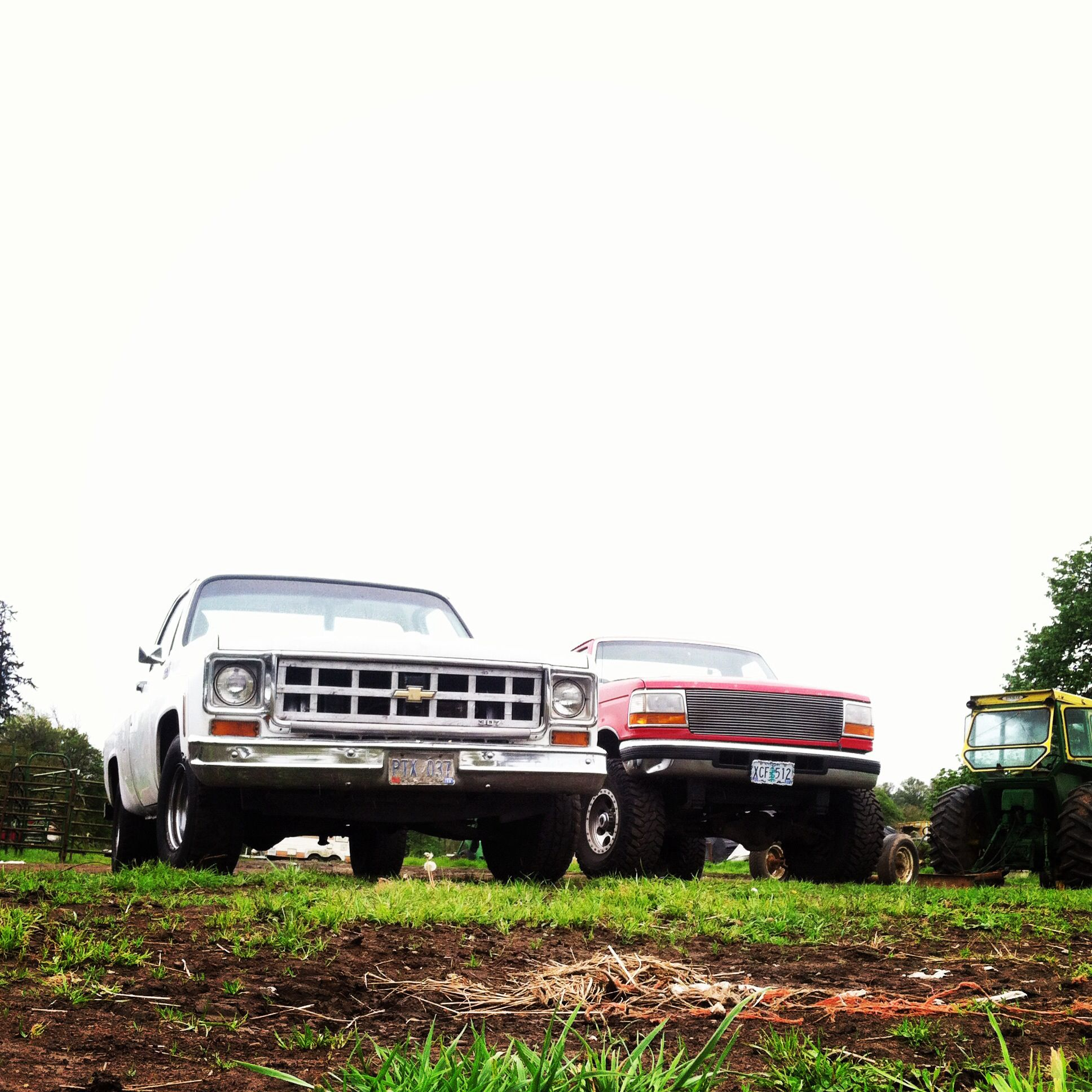 Trucks out in the pasture