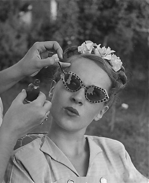 Applying nail polish design to sunglasses, 1947. S)