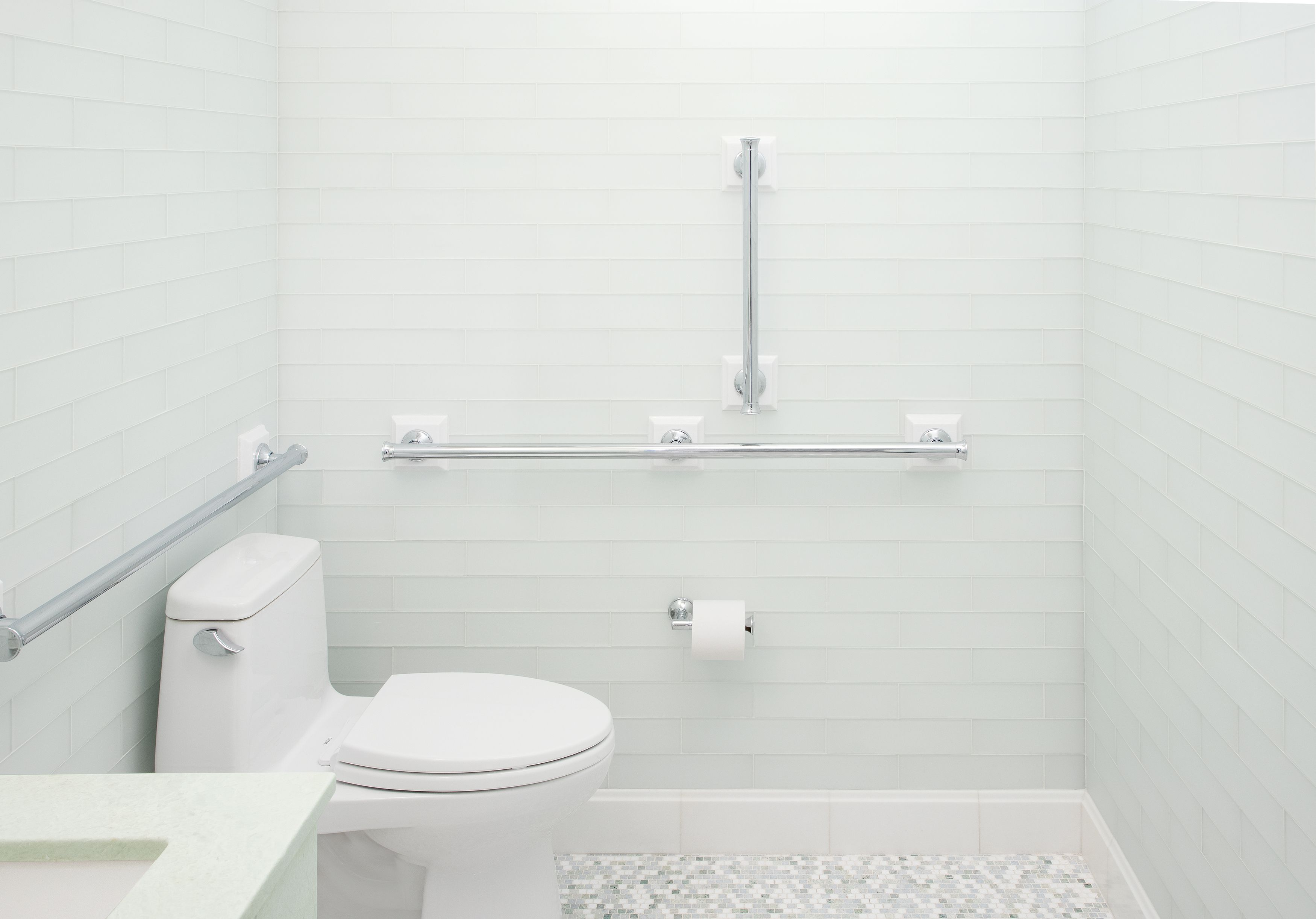 This commercial bathroom design by Denes Petoe, is decked out in ...
