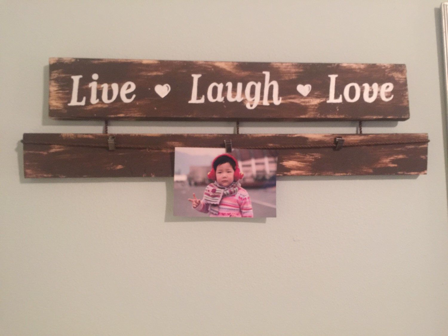 A personal favorite from my Etsy shop https://www.etsy.com/listing/263323986/live-laugh-love-sign-picture-hanger