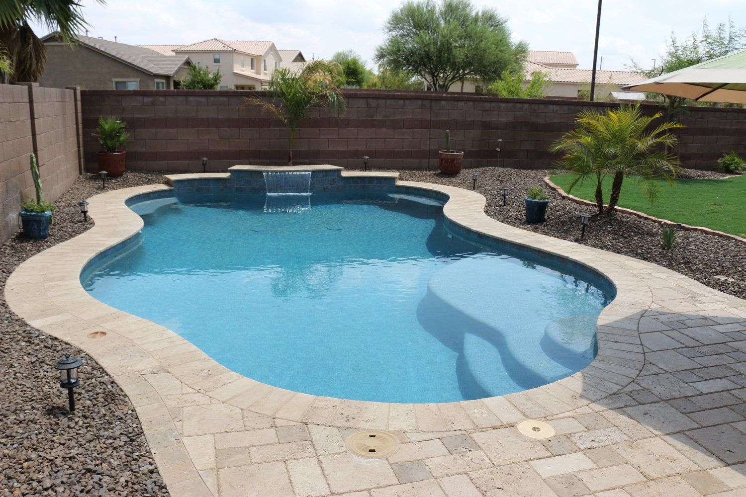 Simple backyards presidential pools spas patio of for Backyard swimming pools