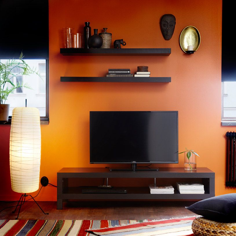 A living room with a wall shelf and a tv bench with drawers, all ...