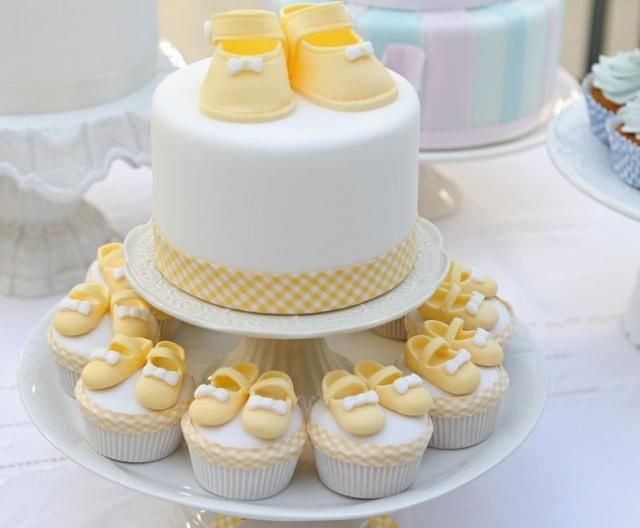 Round White Baby Shower Cake With Yellow Baby Shoes And Matching