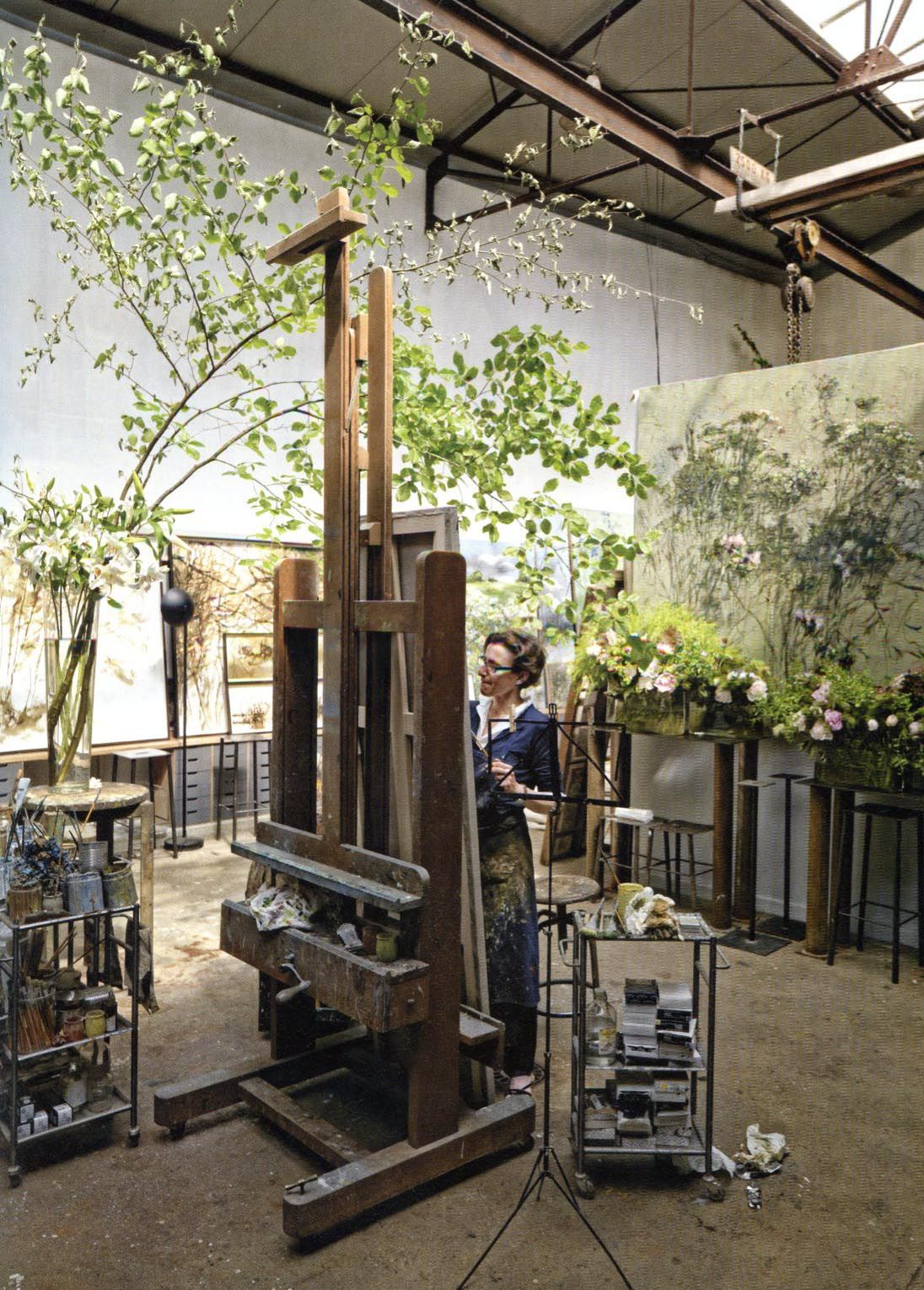 Claire Basler in studio ...I want HER studio! :) It kind of rocks. The space is so open and uncluttered. And it has plants in it! Pretty plants! :)