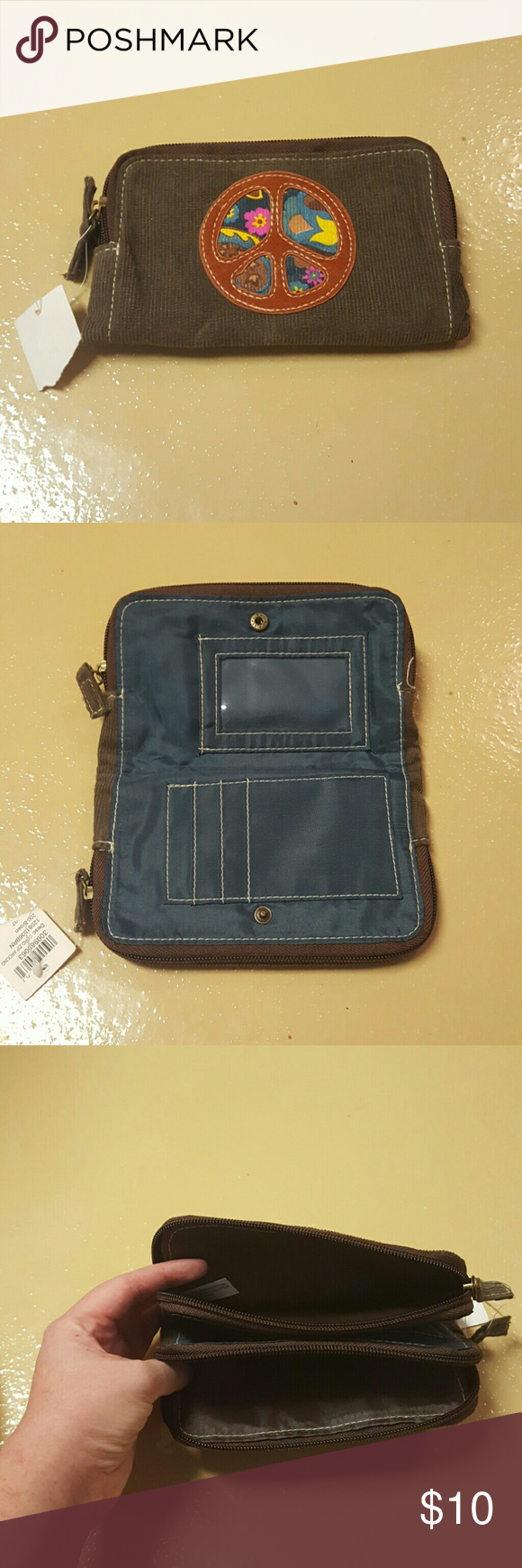 Peace sign wallet NWT. Has middle spot for cards and 2 sipper pockets for change and cash! Bags Wallets