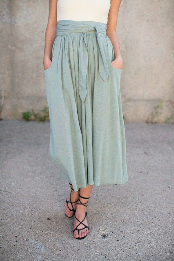 f361497fa9f6 Maxi skirt with sash paired with strappy sandals.