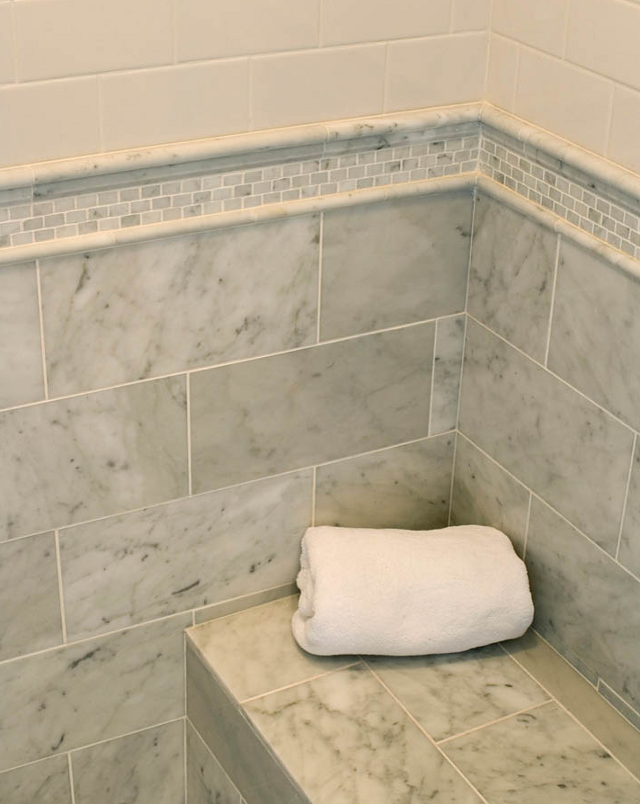 you can mix carrara marble with subway tiles to balance the expenses in a space