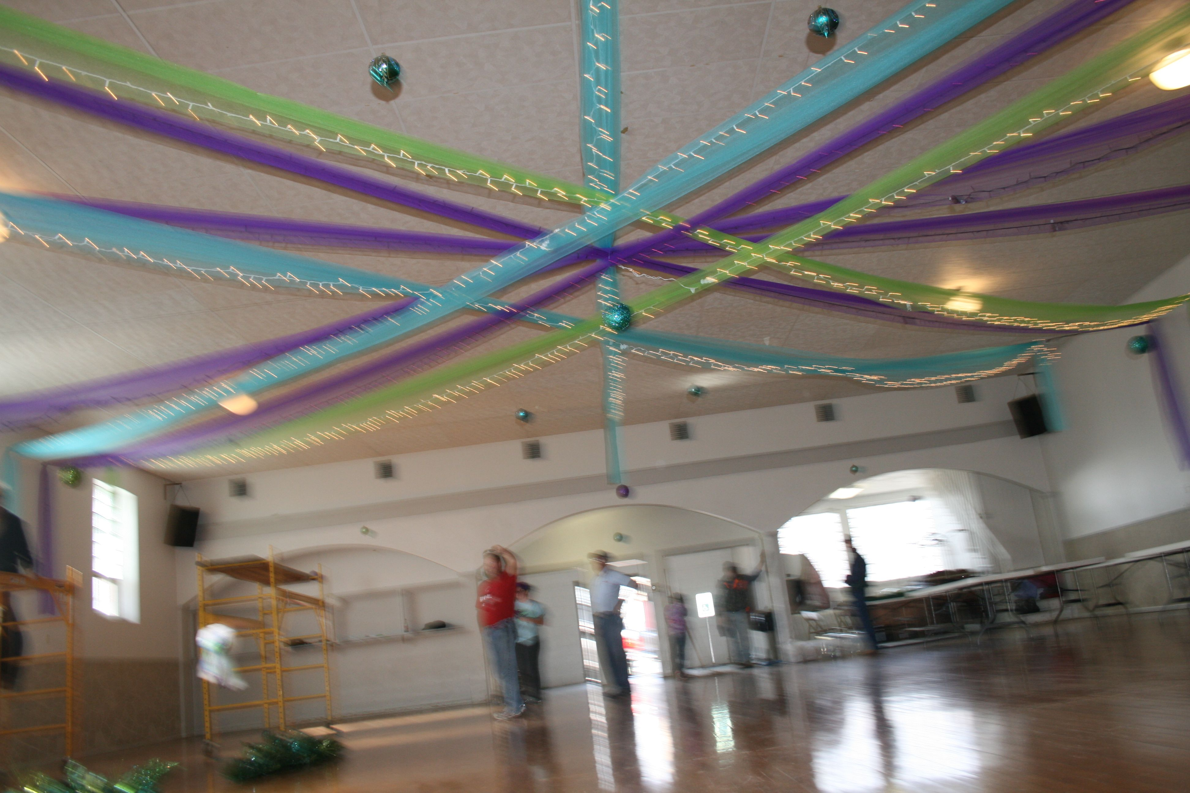 Wedding decorations tulle and lights  Christmas Lights Wrapped in Blue Apple Green and Purple Tulle