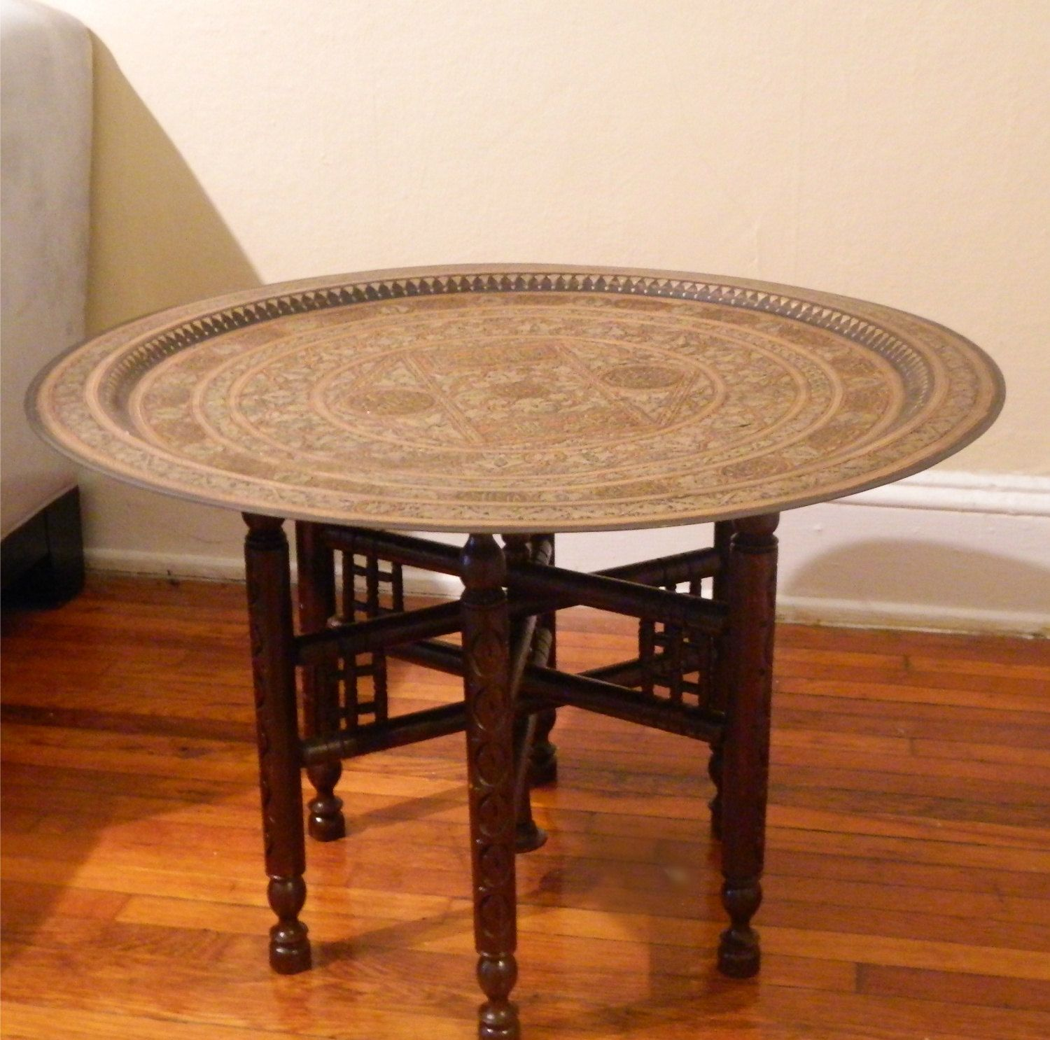 Attractive Round Moroccan Hammered Brass Tray Table. $300.00, Via Etsy.
