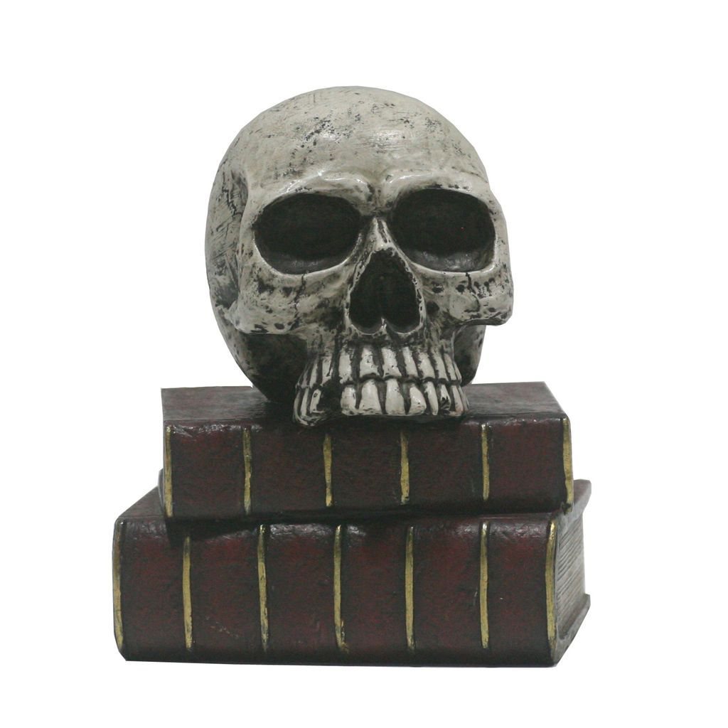 Find the Resin Skull on Red Books Figurine By Ashland® at Michaels - michaels halloween decorations