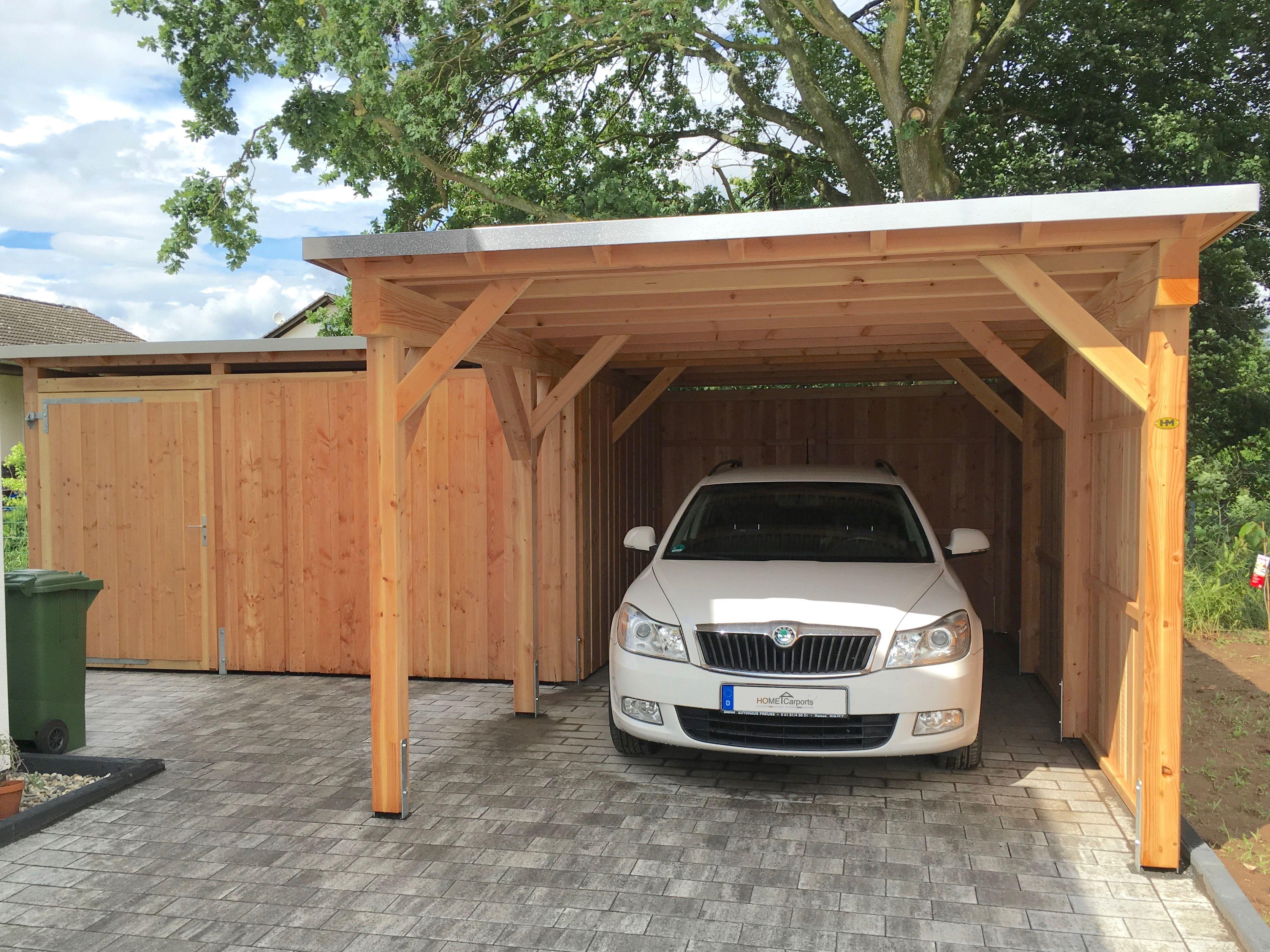Holz Carport aus Douglasie mit einer Aluminium Designblende sowie