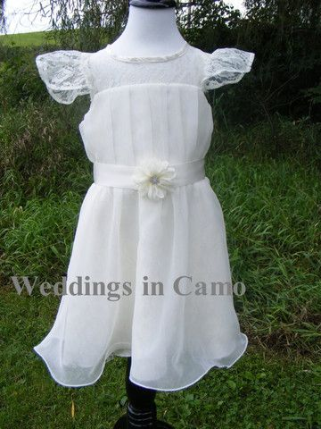 Short chiffon Flower girl dress, with lace upper bodice and sleeves. The ribbon sash is accented with a daisy and rhinestone center. Price starts at $113.50  Knee length for your COWBOY BOOTS! www.weddingsincamo.com
