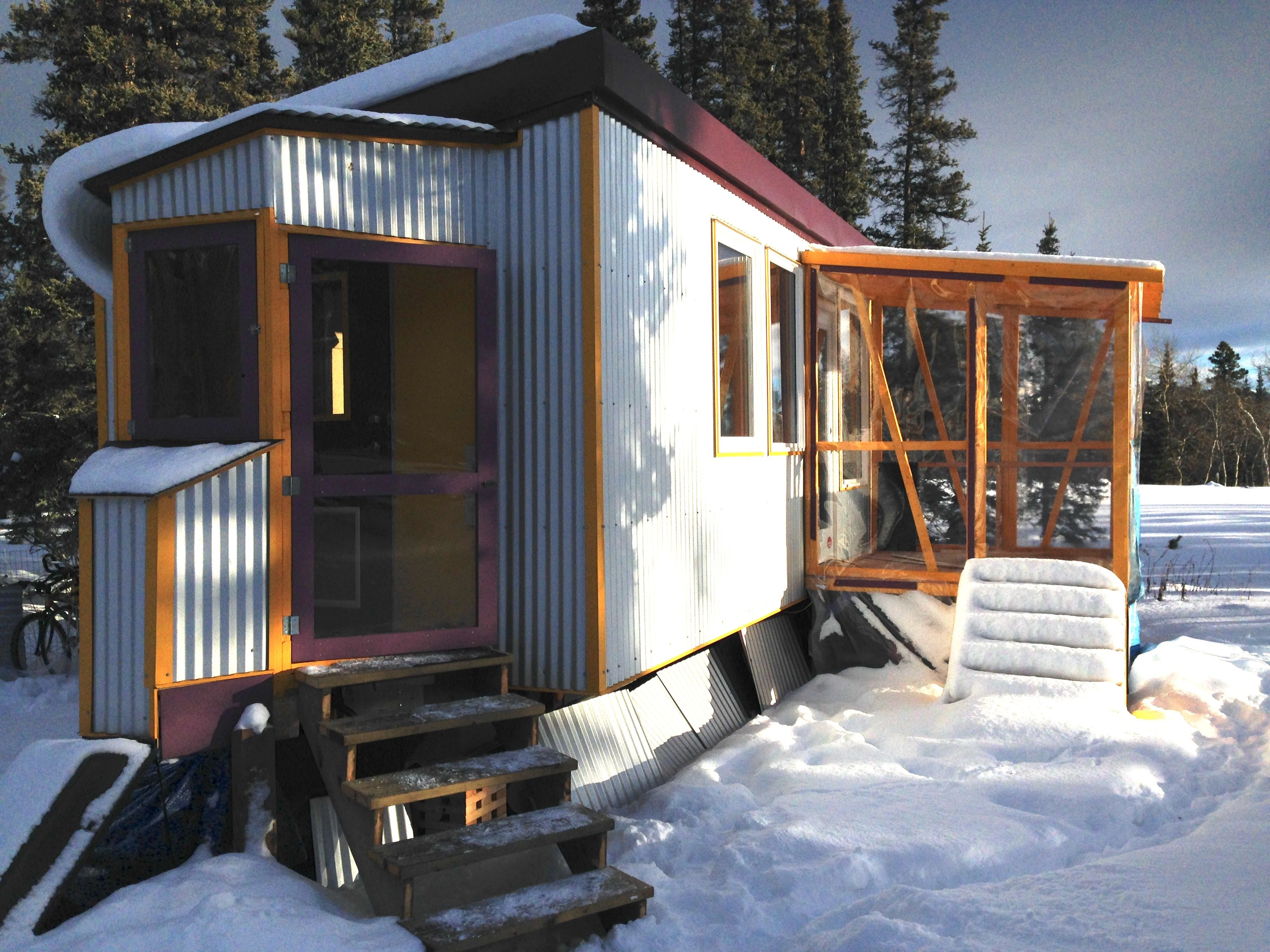 A tiny house for sale on one level built to handle arctic cold to