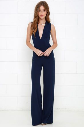 b9ca2092bee2 You ll cause some serious outfit envy when you strut your stuff in the  Cat s Meow Navy Blue Jumpsuit! Medium-weight stretch woven fabric begins  with a ...