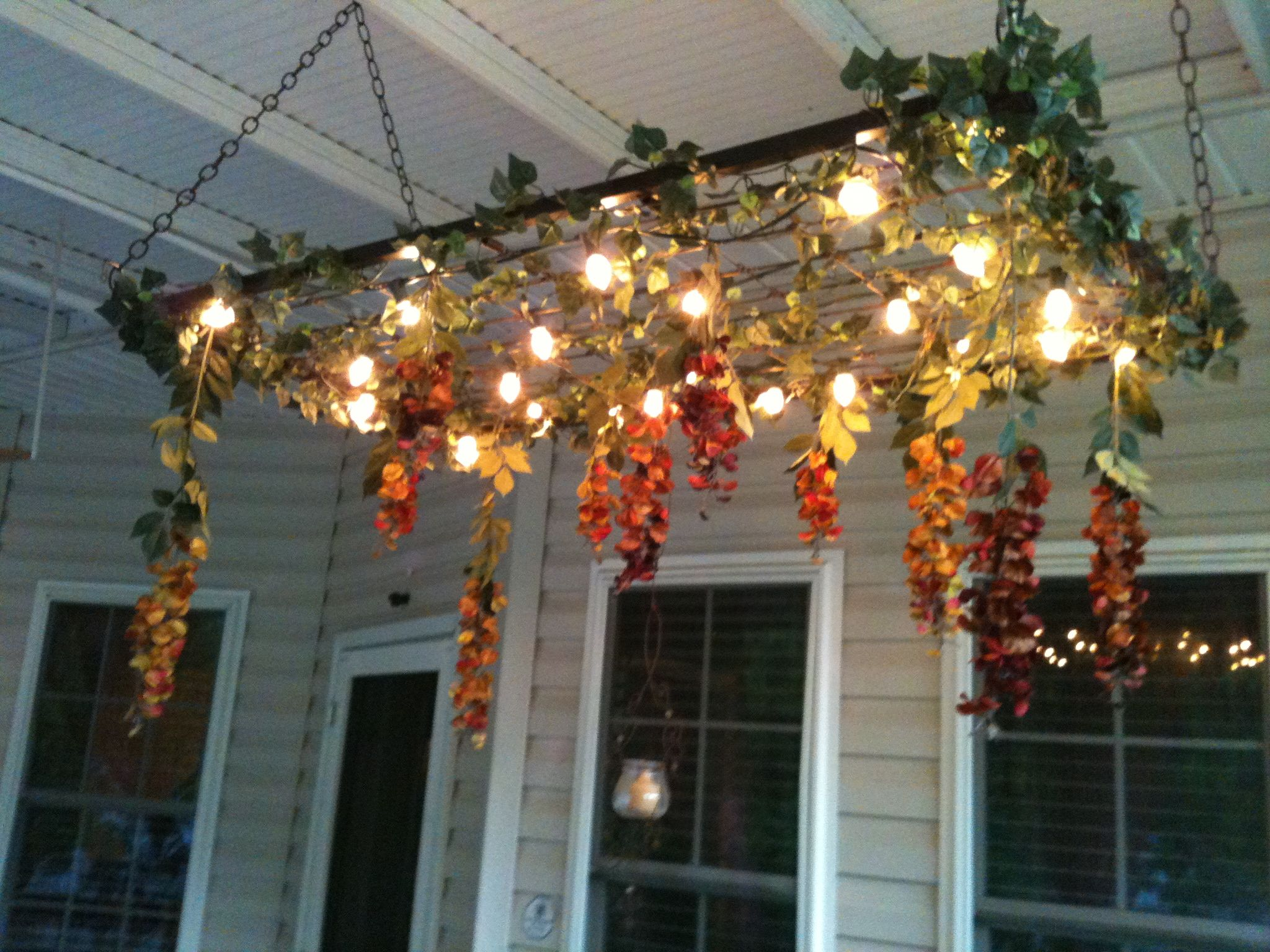 The Porch Chandelier I Made For Our Deck Out Of A Crib Box Spring Bed Spring Crafts Cribs Repurpose Bed Springs