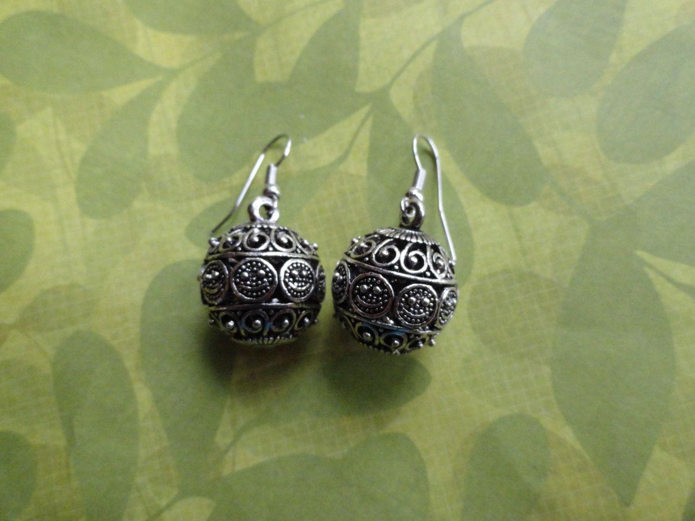 Filigree ball metal earrings fun and funky ball earrings are made