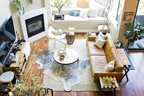 Layered rugs are a trend! Get a bolder look and highlight your house