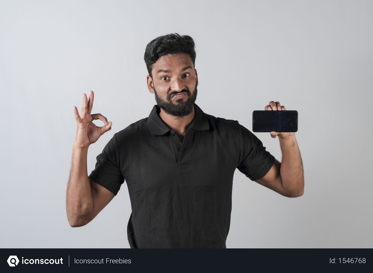 Free Indian Man Holding His Smartphone With Blank Screen With Ok Hand Gesture Photo Download In Png Jpg Format Indian Man Man Photo