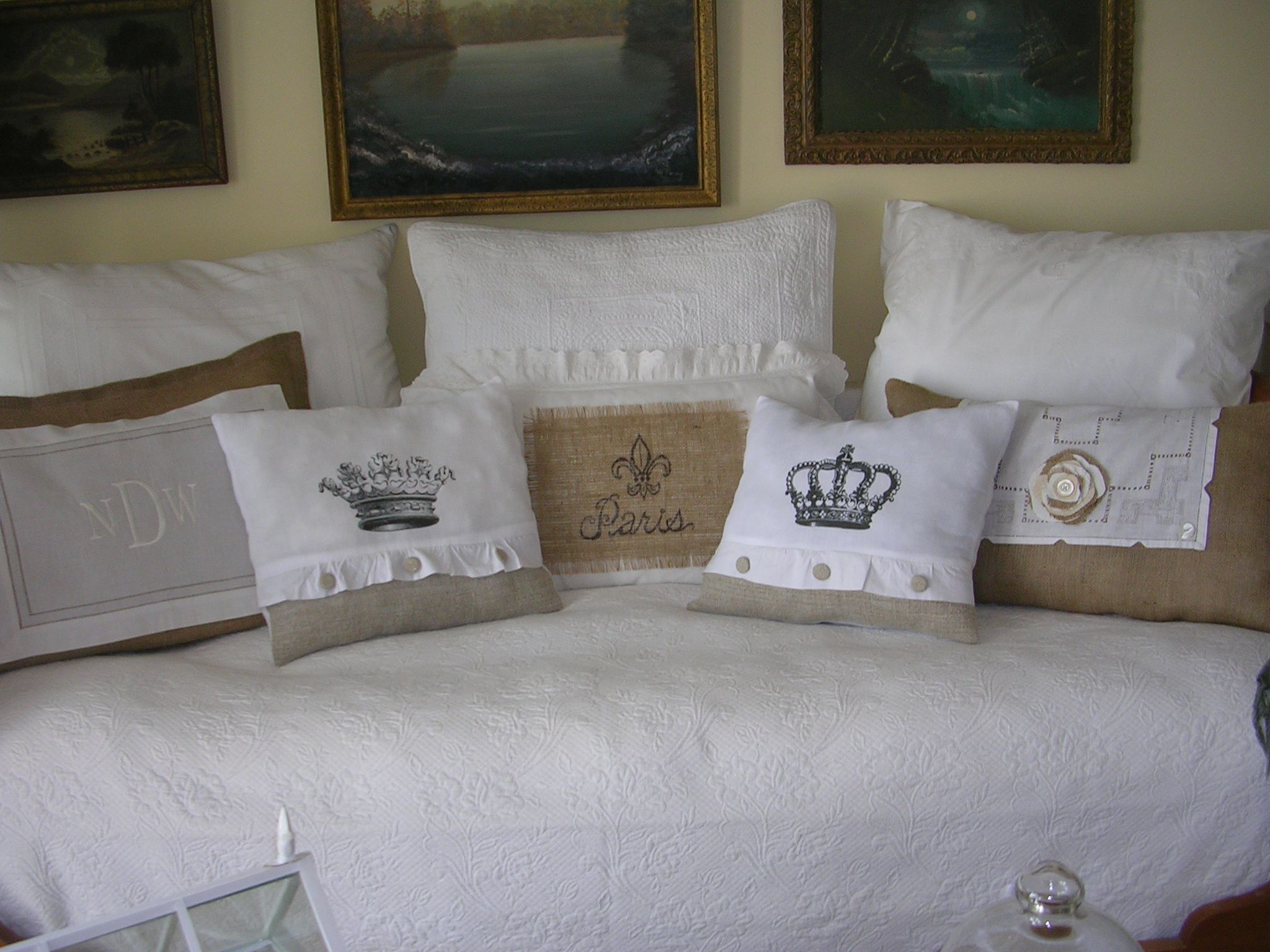 Daybed pillows made from french tea towels and antique grain sacks