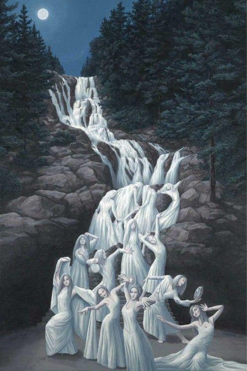 Pintura que simula a mujeres que bajan de una montaña de piedras bailando