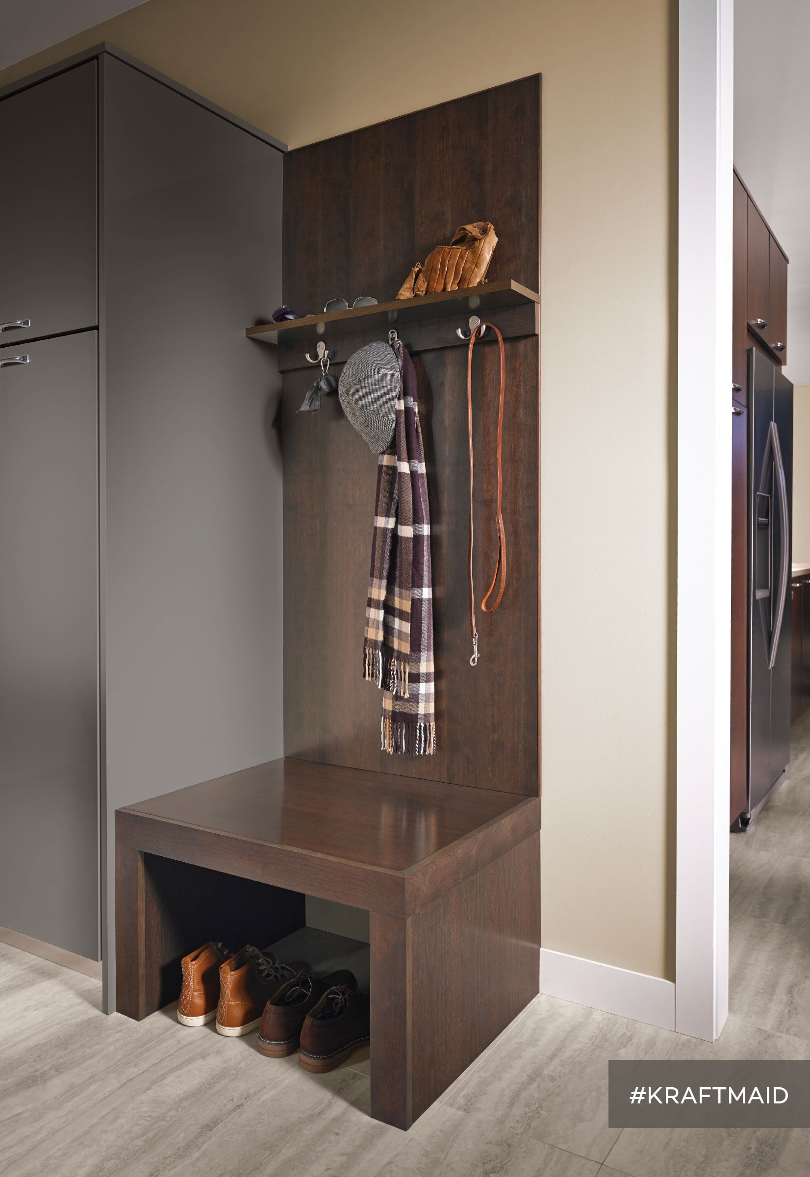 The seating area in this contemporary mudroom has plenty of hooks