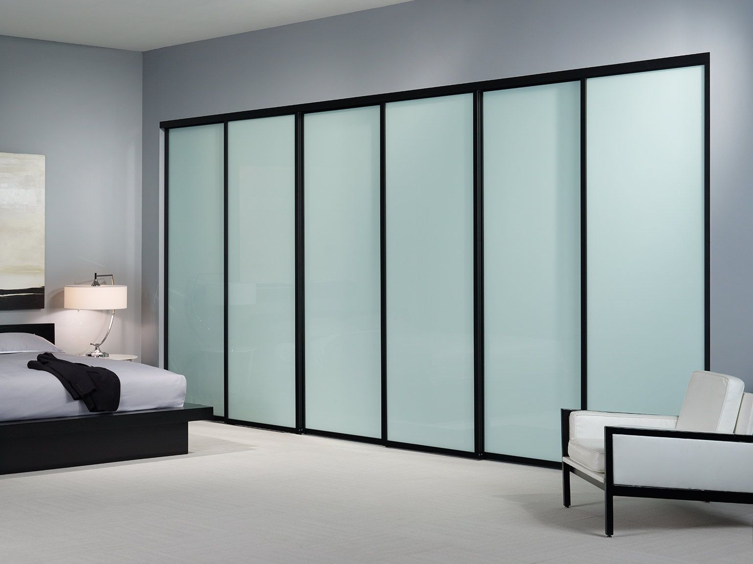 Sliding Glass Closet Doors Are Perfect For Extra Large Closets Installed Here With Milky And Black Frame Finish