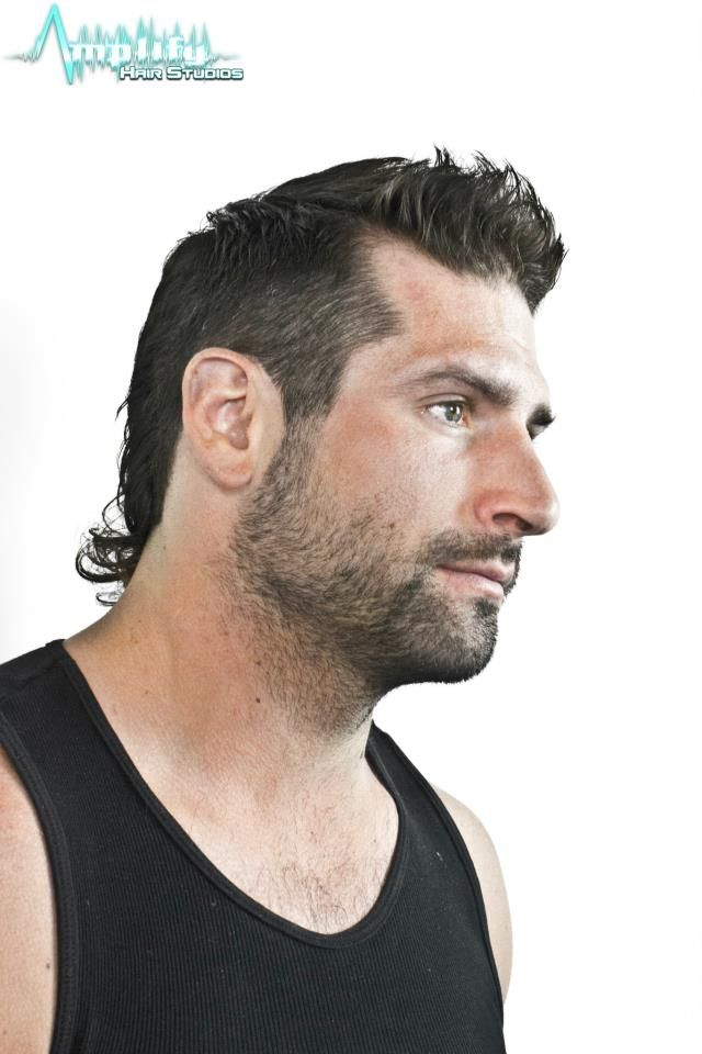 A short curly hair men's hairstyle with beard combination ...