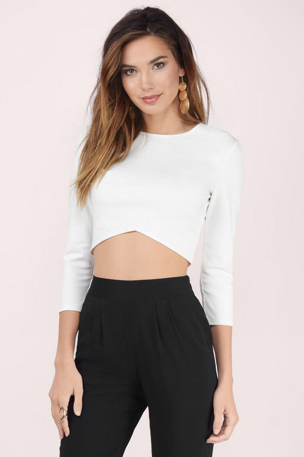 The Make The Cut Crop Top is a classic with a twist. Crop top with an angled hem and back keyhole. Wear with a skater skirt and heels.