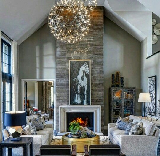 Dark Rustic Wood Floors, Stone Fireplace, Orb Chandeliers, Horse Art Is  What Makes For A Great Room