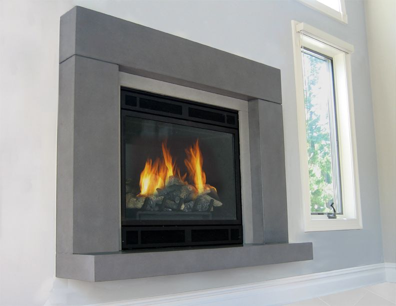 gas fireplace with a concrete fireplace surround and