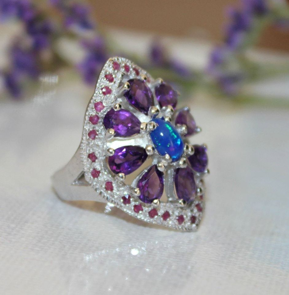 Silver ring with rhodium finish. Rocks: amethysts, dark blue opal and small rubies Sold by Jewellry 164,00 $