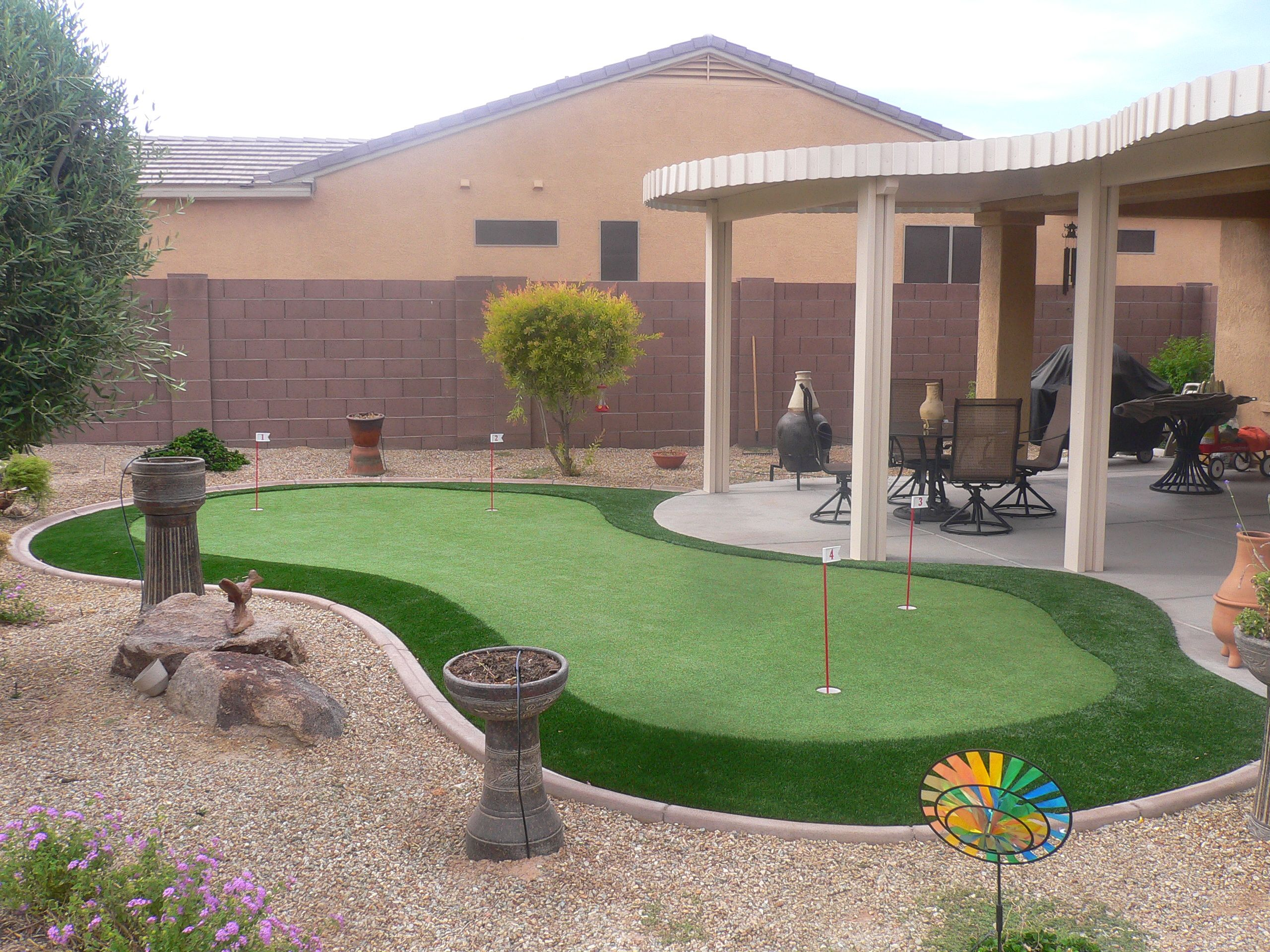 Mix and match your flagsticks on your putting green to ... on Backyard Desert Landscaping Ideas On A Budget  id=42317