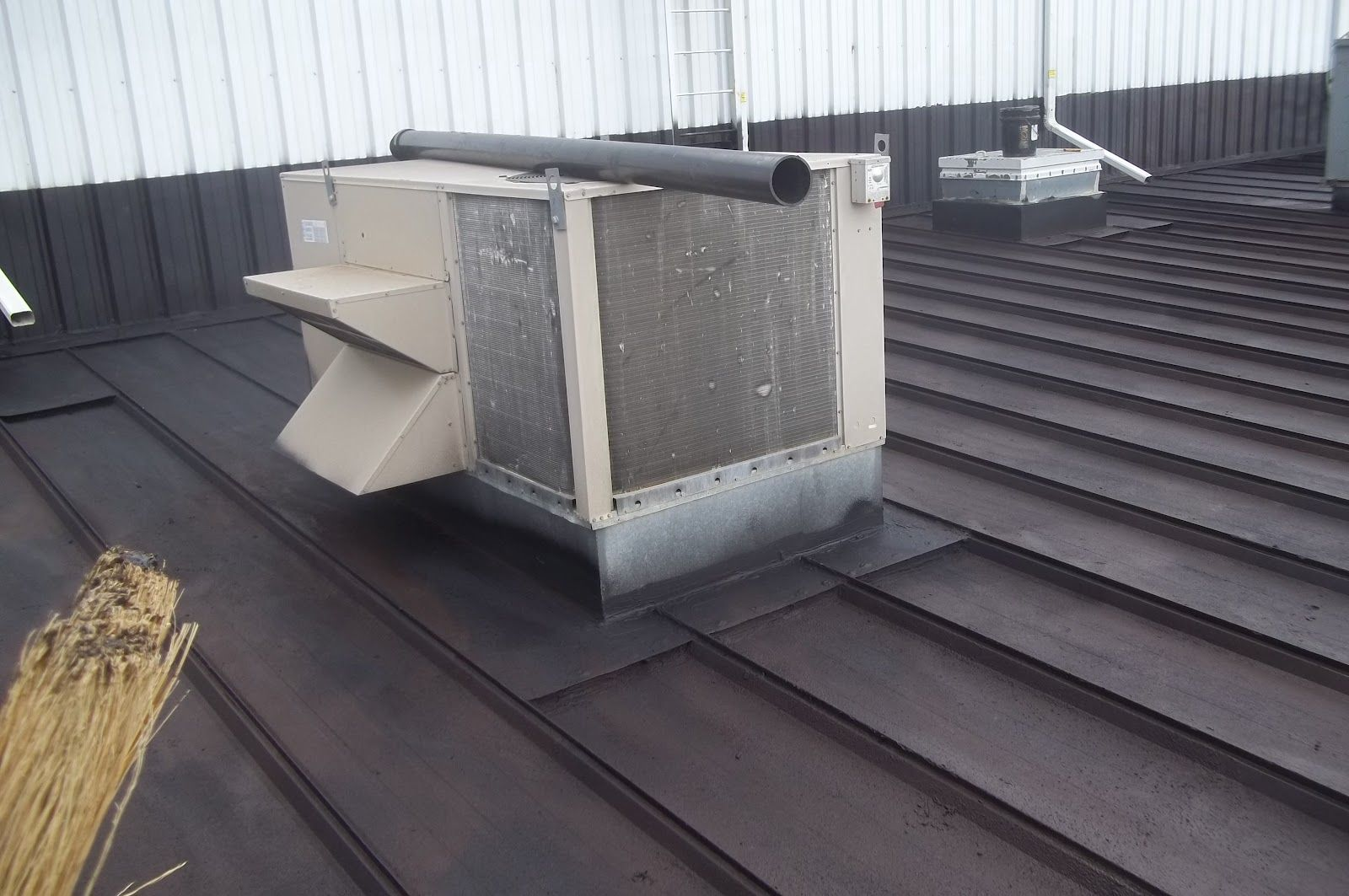 Roof Repair Liquid Rubber Metal Roof Leak Repair Maintenance General Roofing Systems Canada Grs Metal Roof Leaks Liquid Rubber Flat Roof Maintenance