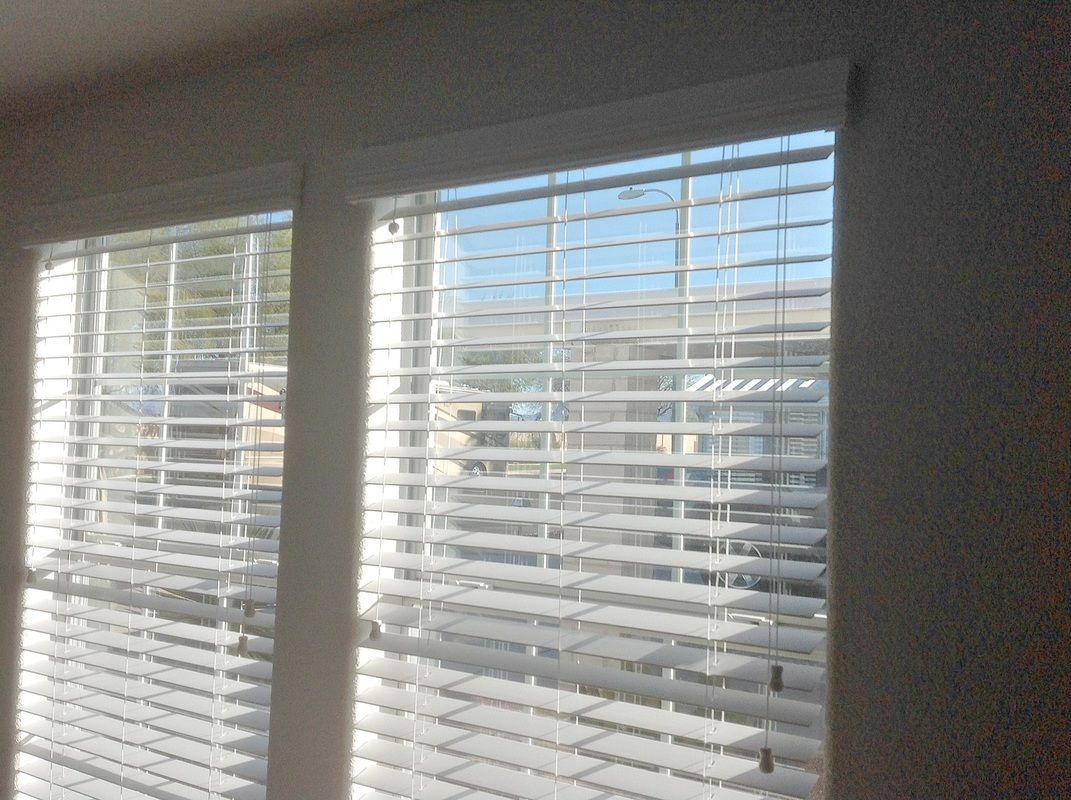 Faux wood blinds in a vacation home latreia wood and faux wood