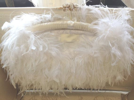 Stunning White Ostrich and ruffle feather shrug with hook & eye for fastening with sumptious satin lining. Deep luxurious plumes oooze 1930s
