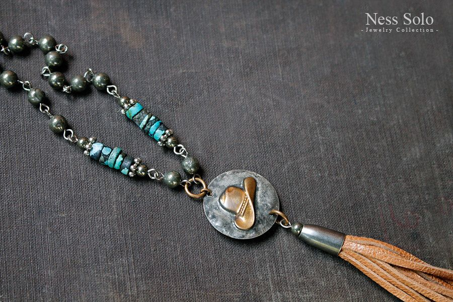 Western necklace Western jewelry Cowgirl Southwestern jewelry Pyrite & genuine turquoise necklace Leather tassel necklace Cowboy hat pendant by NessSolo on Etsy https://www.etsy.com/listing/248562722/western-necklace-western-jewelry-cowgirl