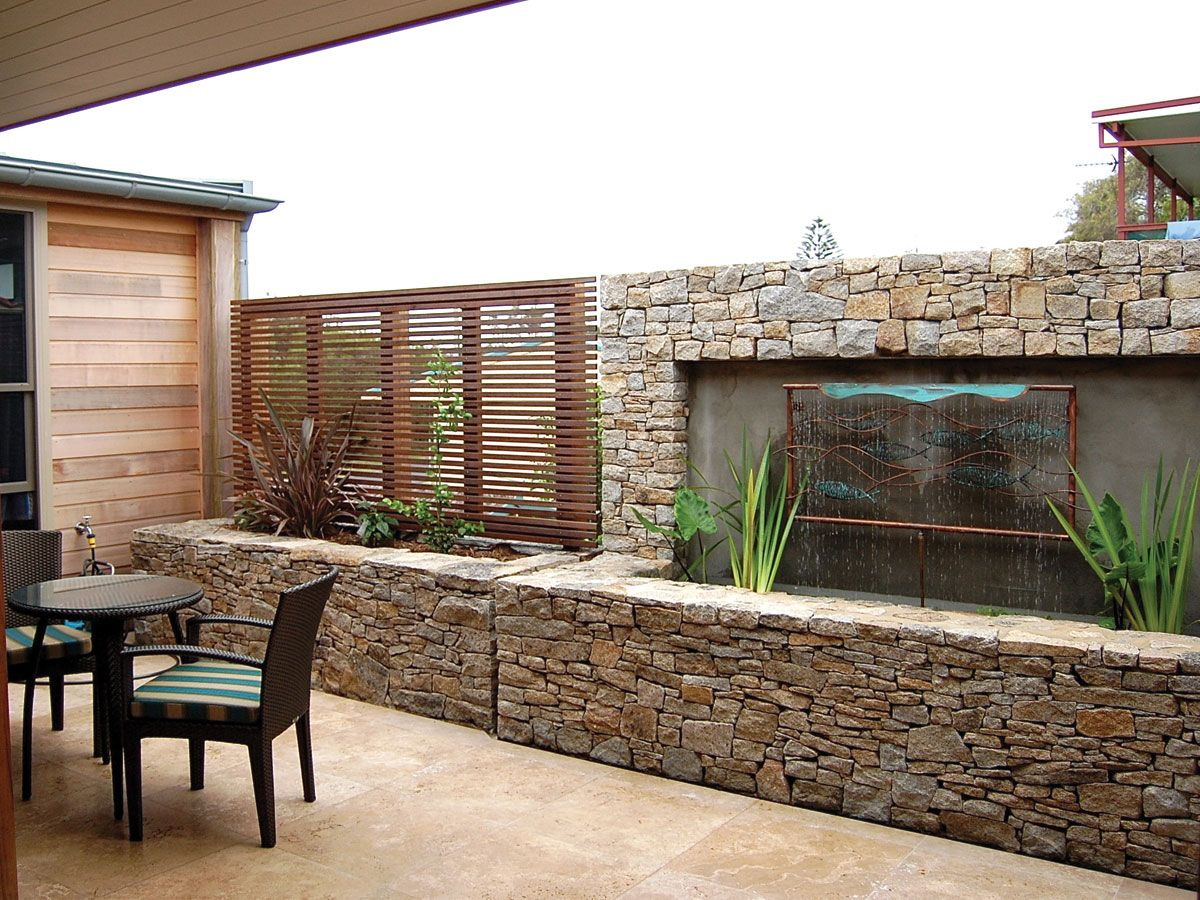 Cotswold Cladding retaining wall water feature supplied by
