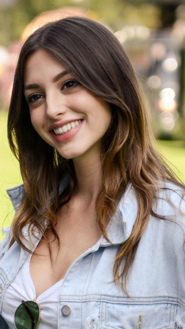 Celine Farach Smiling Torn Jeans Shirt 720x1280 Wallpaper Face