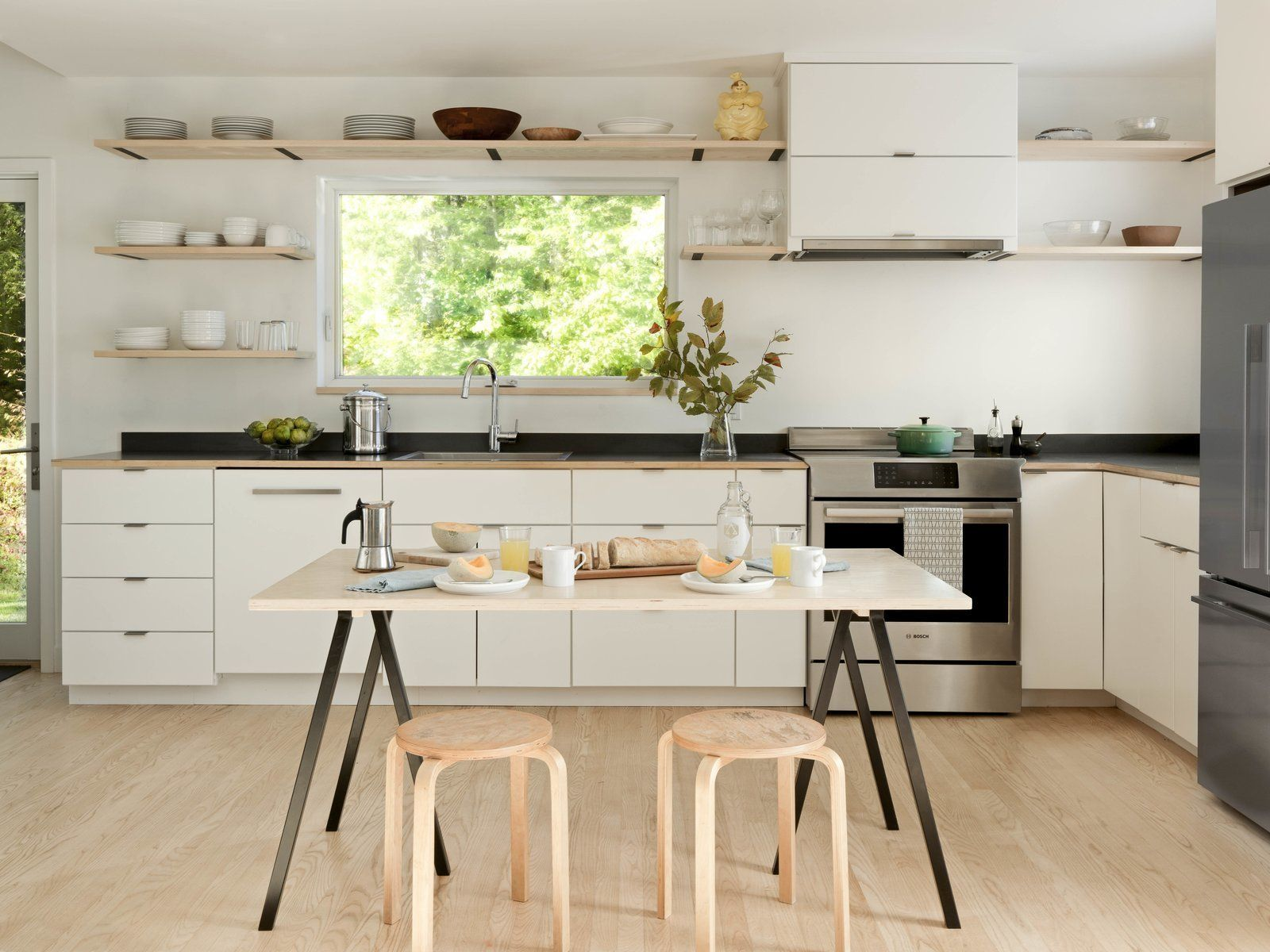 Photo 1 Of 13 In A Little Black Cabin Keeps Things Simple For A In 2020 Kitchens Without Upper Cabinets Black House Upper Cabinets