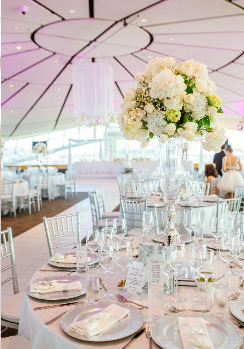 Stunning wedding reception with an elegant white theme! Photo Credit ...