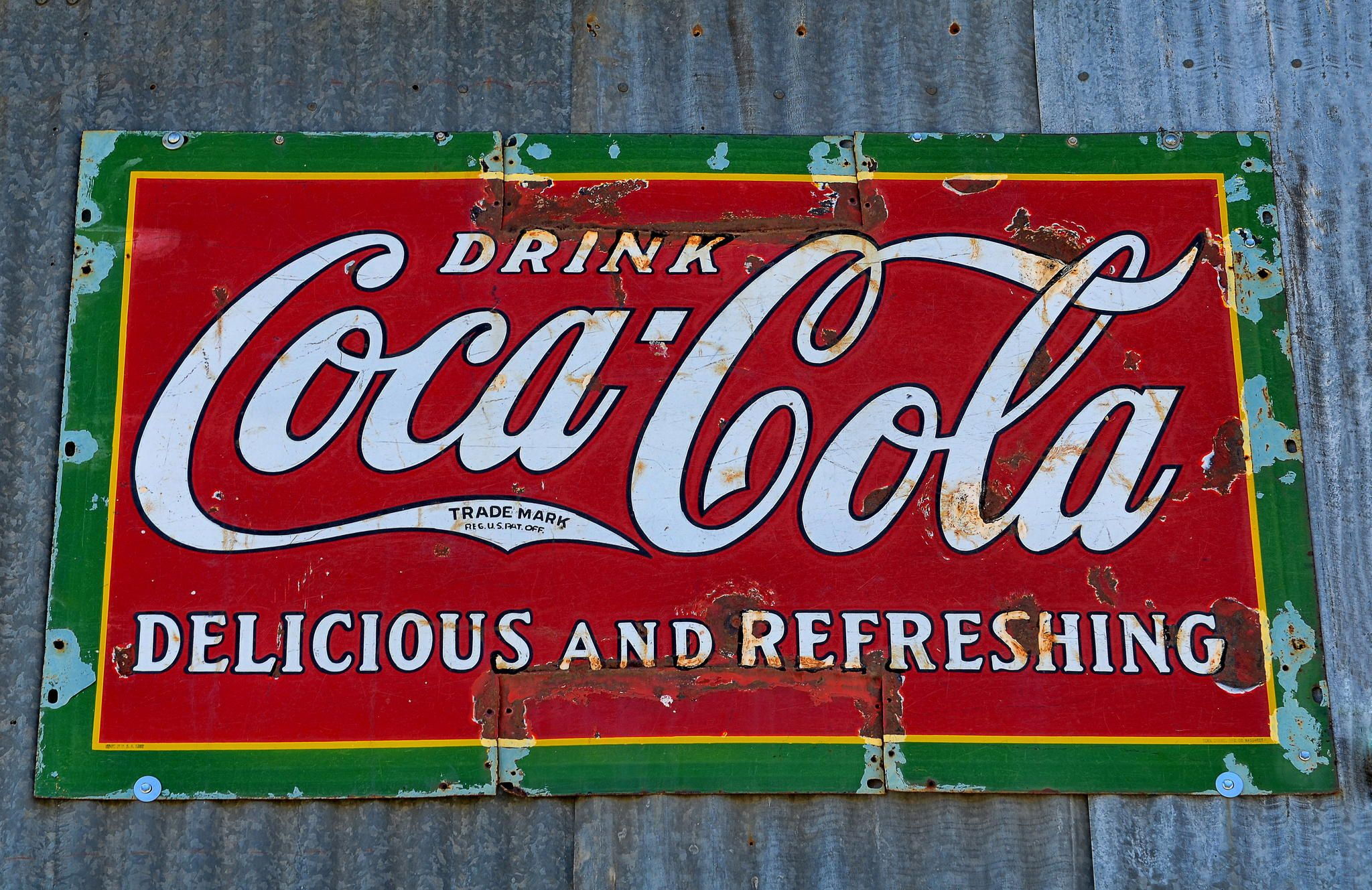Coca Cola - An old and rusted Coca Cola sign.