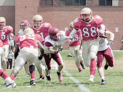 Lions clinch West title with win- another of my pics in Cambridge Times ( 2 in the same day!)