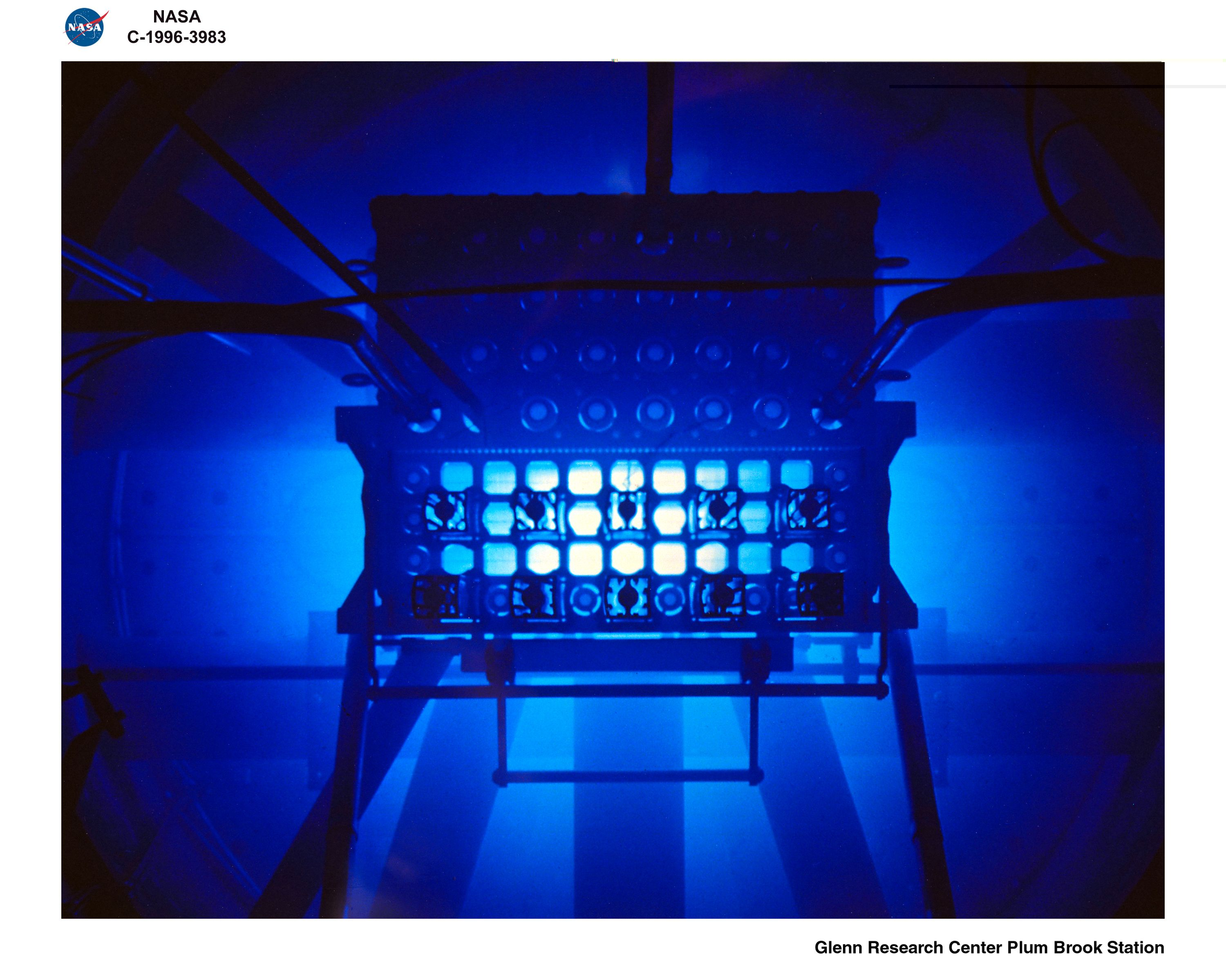 During criticality, the Plum Brook Reactor core emitted an eerie blue glow known as Cherenkov radiation. This is common to all swimming pool reactors. The Cherenkov Effect is caused by high-energy beta particles moving at velocities faster than the speed of light in water. Pavel Alekseyevich Cherenkov first observed the phenomenon in 1934.