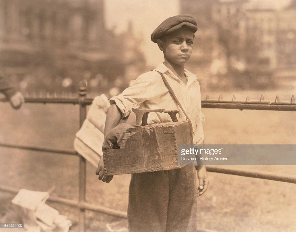 Young Boy Working as Bootblack, City Hall Park, New York City, USA, circa 1924.
