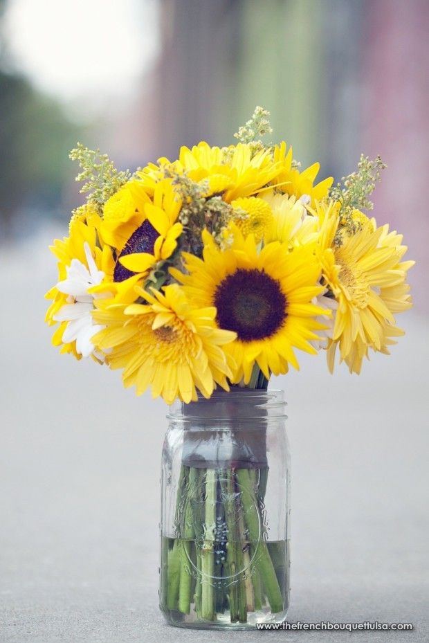 Sunflower centerpiece in mason jar flowers vases
