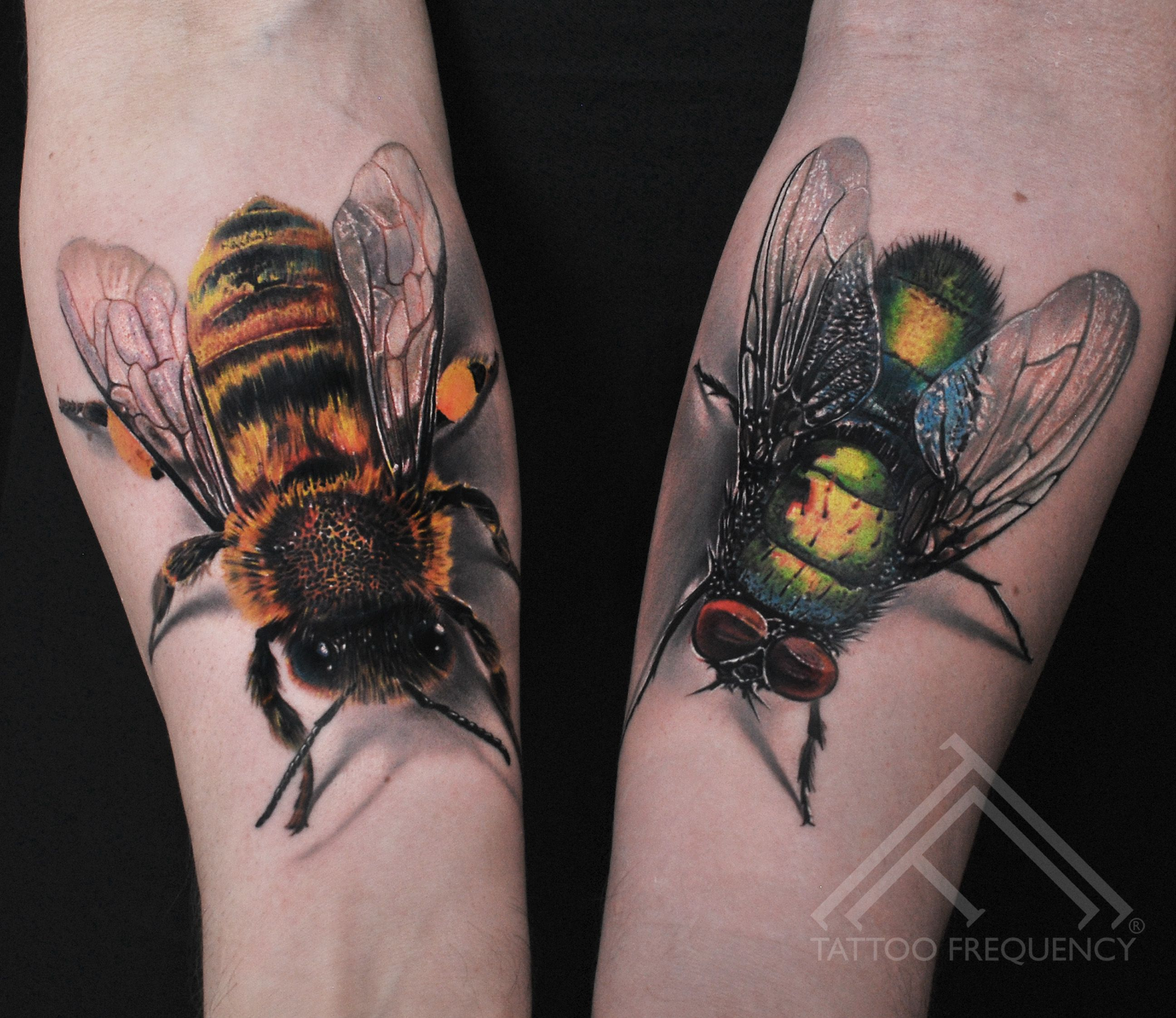 Freshly Done Realistic Symbolic Bee And Fly On Mans Arms Artist