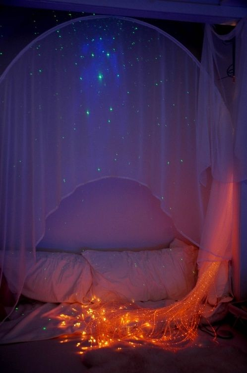 Moon to Moon. draping fabrics and fairy lights. fairytale space bedroom