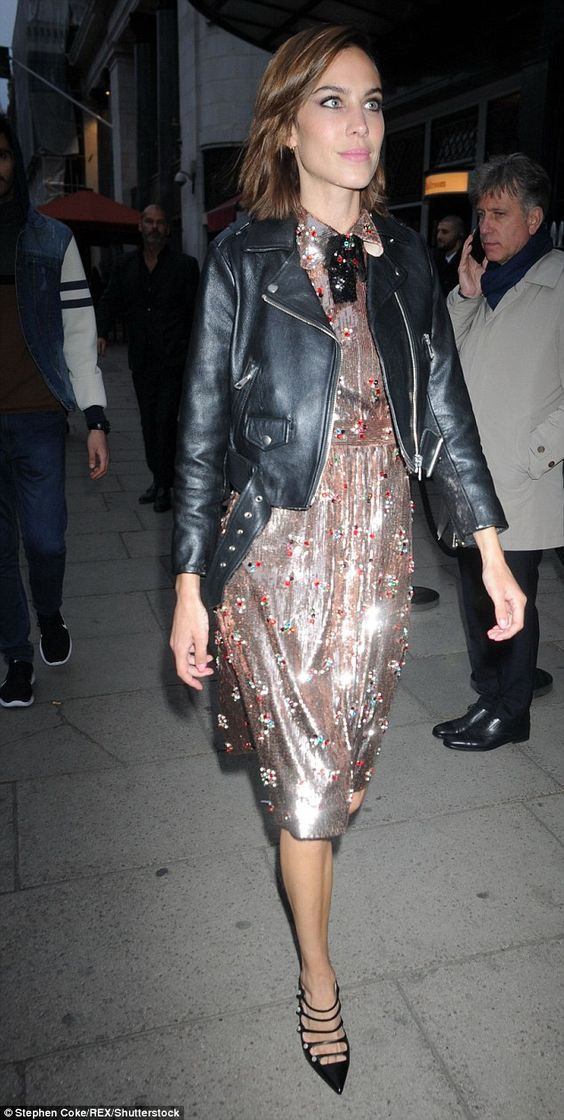 22c2b5bfff7 Alexa Chung rocking the dressed up biker look with black leather biker  jacket and sequin dress