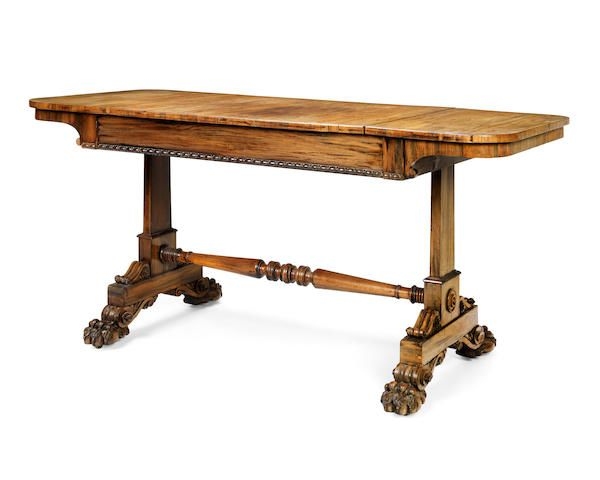 A George IV goncalo alves writing table in the manner of Gillows